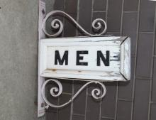 Ornate wood Men sign with metal fittings