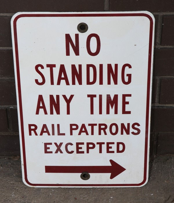 No Standing Rail Patrons Excepted enamel sign