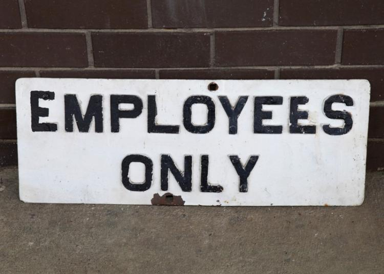 Cast iron Employees Only sign