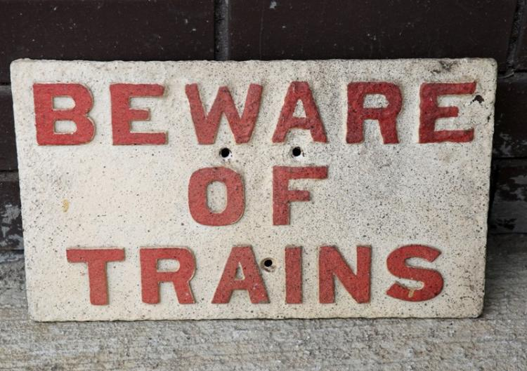 Cast iron Beware of Trains sign - red and white