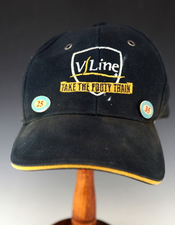 Vline cap with service badges