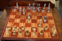 Wood chess board with crusader themed pieces (metal)