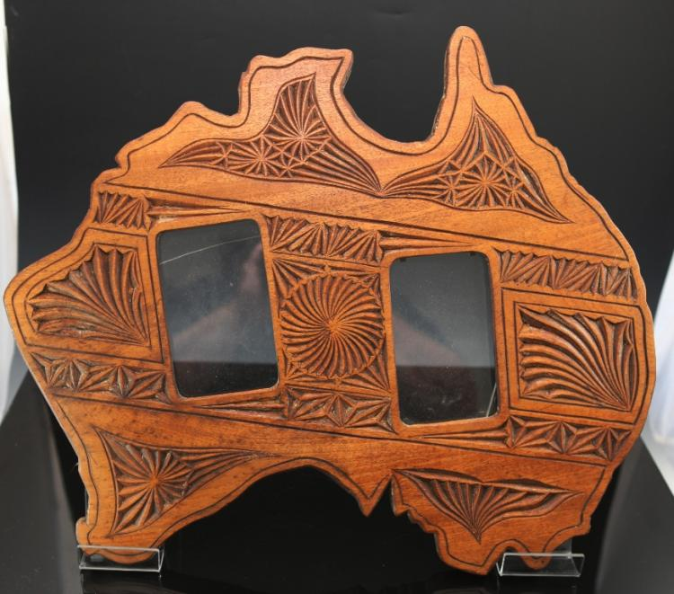 Chip carved picture frame in the shape of australia