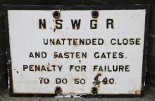 Cast iron NSWGR Unattended Close and Fasten Gates $40 penalty sign