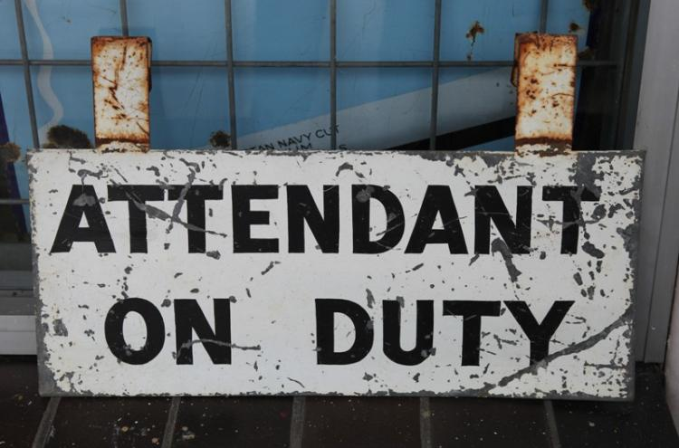 Attendant on Duty sign