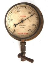 Brass feet of water gauge A/F