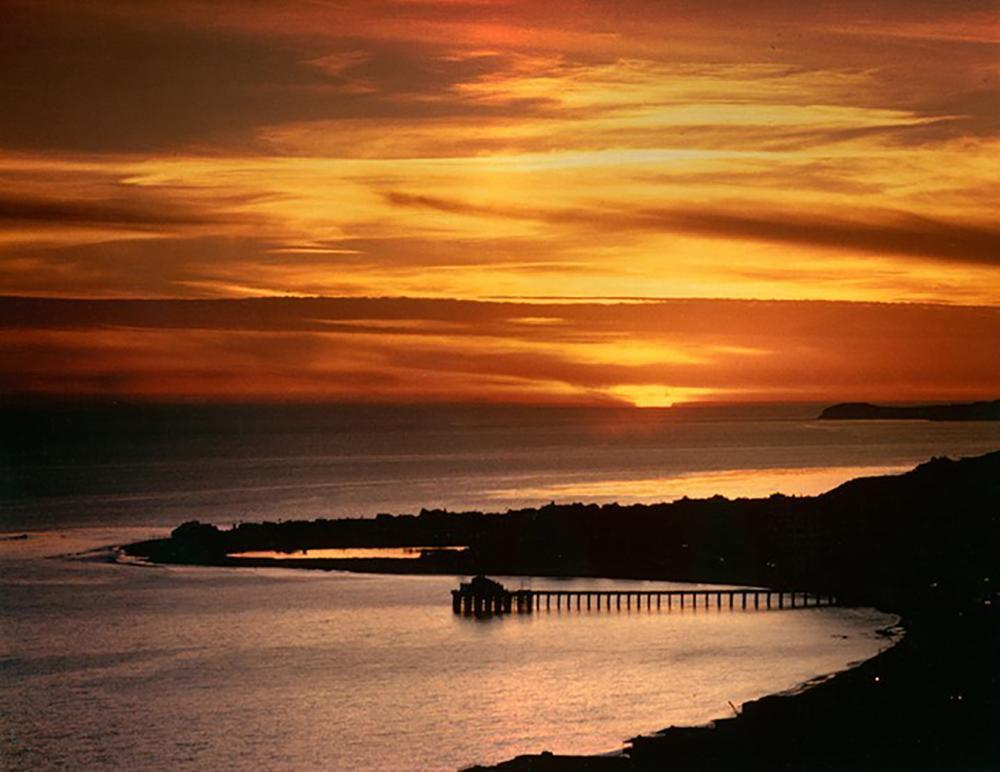 Lot 4820: Nick Rodionoff-Sunset over Looking Pier Photography on canvas
