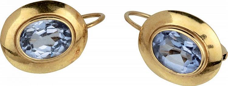 Gold and aquamarine earrings.