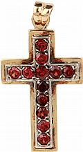 Gold and silver cross with garnets.