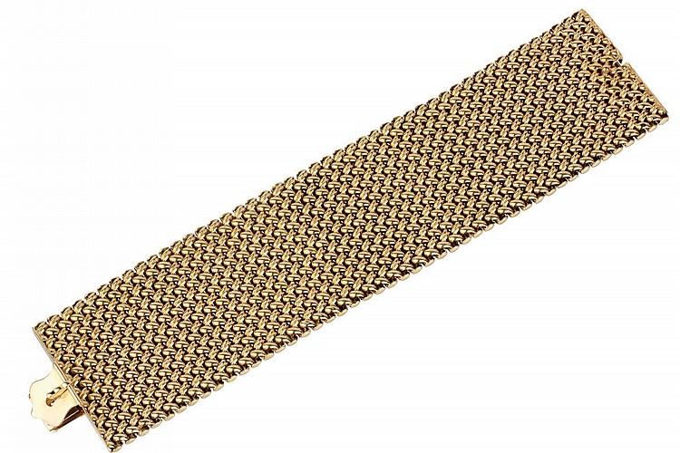 Gold wide bracelet.