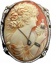 Shell cameo brooch with diamonds.