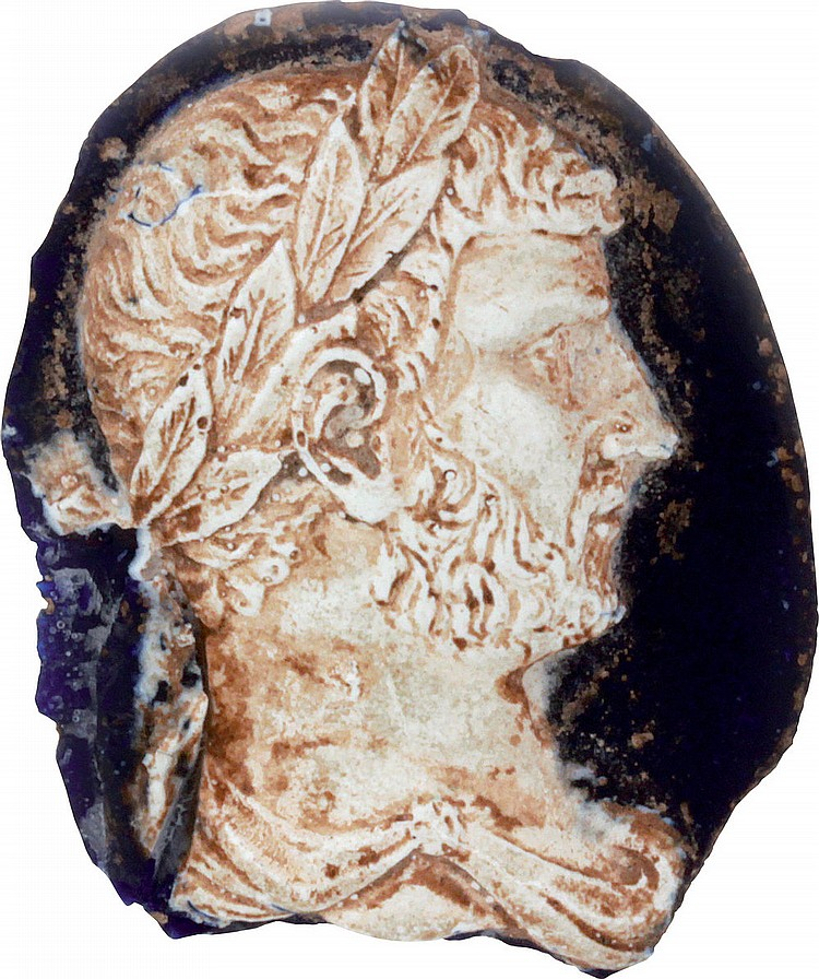 Antique glass cameo with features of the emperor Hadrian.