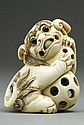 ANTIQUE JAPANESE CARVED IVORY NETSUKE OF A FOO DOG