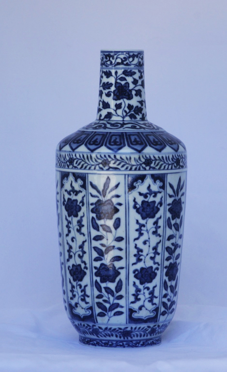 A blue and white narrow necked vase