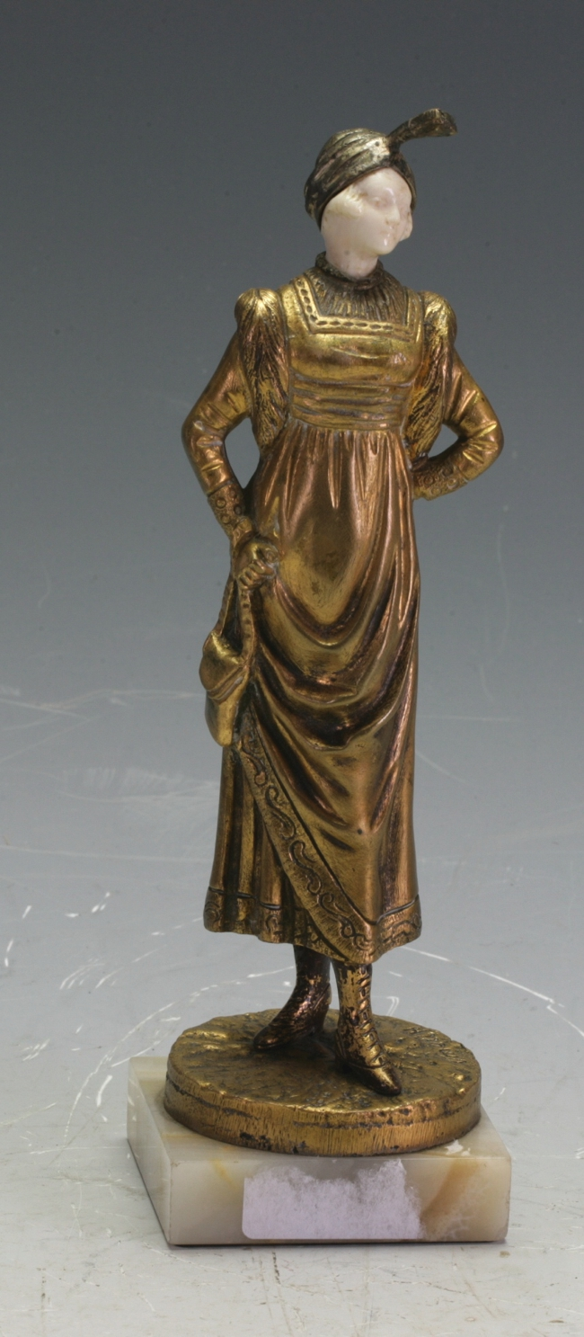 A bronze and ivory figure