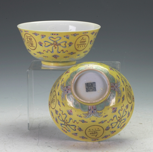 A pair of yellow bowls