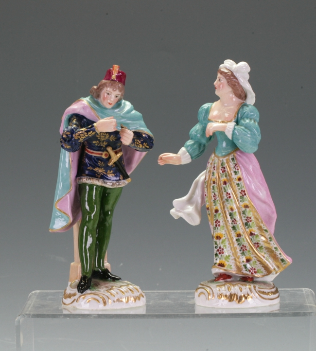 A pair of European figures