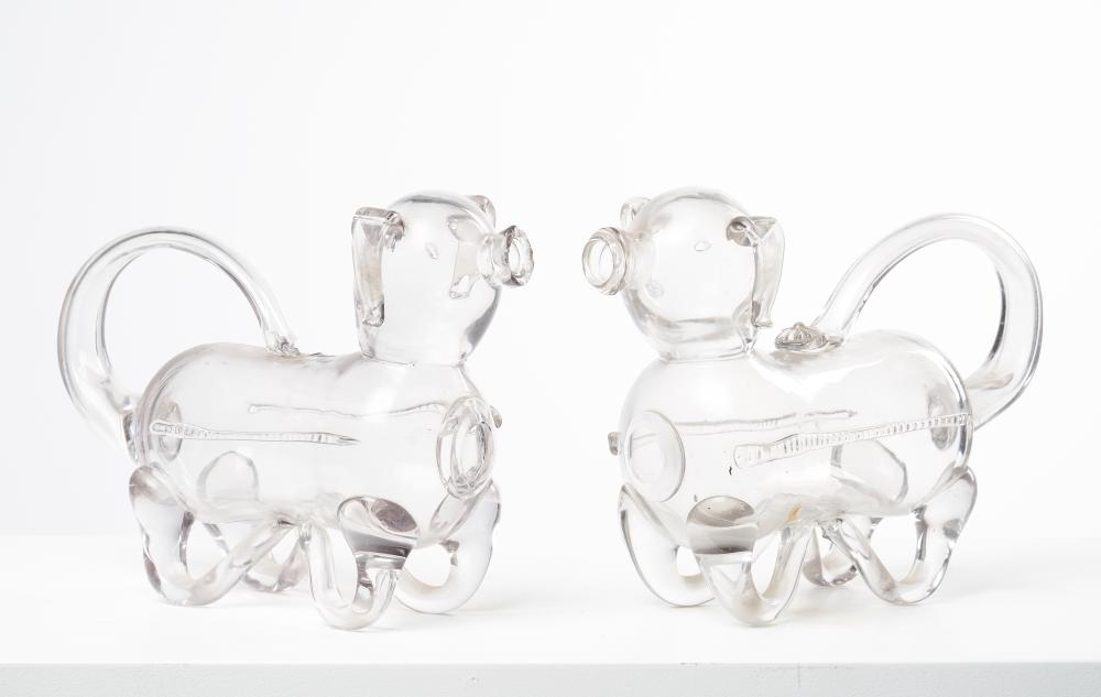 A pair of glass decanters in the form of dogs, Possibly English, circa 19th century