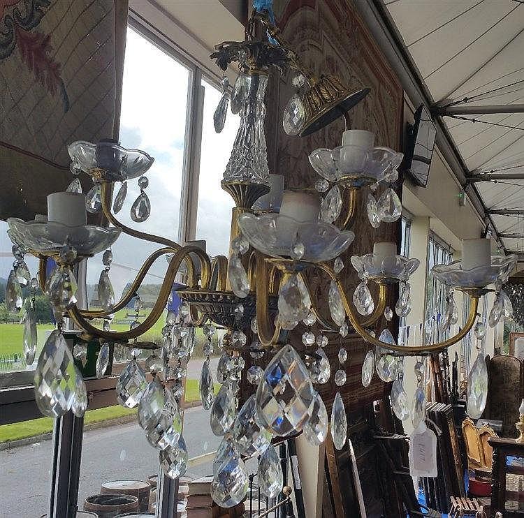 a lovely delicate nine branch brass chandelier with crystal. Black Bedroom Furniture Sets. Home Design Ideas