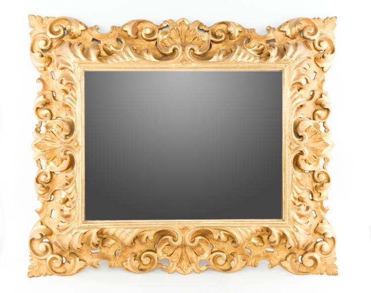 Bella coppia di specchiere in legno intagliato e dorato, XVIIIXIX secolo. | Beautiful pair of mirrors in carved and gilded wood, XVIII  XIX Century.