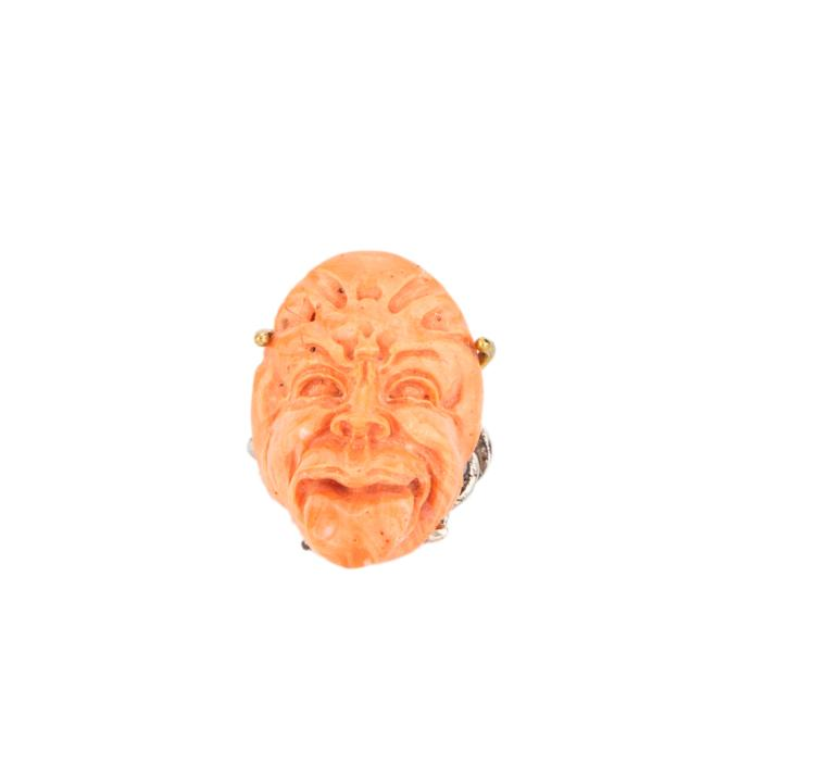 Maschera satirica in corallo. | Satirical mask, pink coral