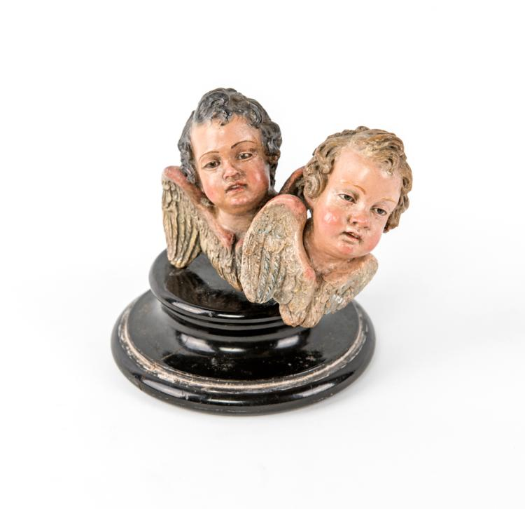 Due testine di cherubino | Two heads of cherubs