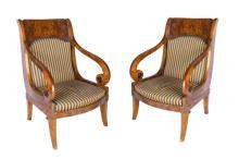 | Coppia di poltrone in piuma di mogano stile impero XX Secolo | A Pair of Empire style mahogany Armchairs