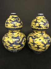 A PAIR OF YELLOW GLAZED AND BLUE AND WHITE GOURDS