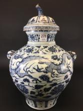 A BLUE AND WHITE DRAGON JAR WITH LID