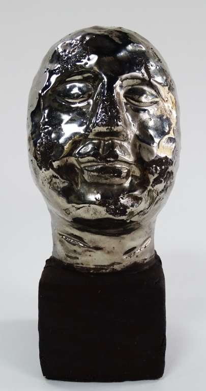 VINTAGE POTTERY BUST WITH STAINLESS STEEL FINISH