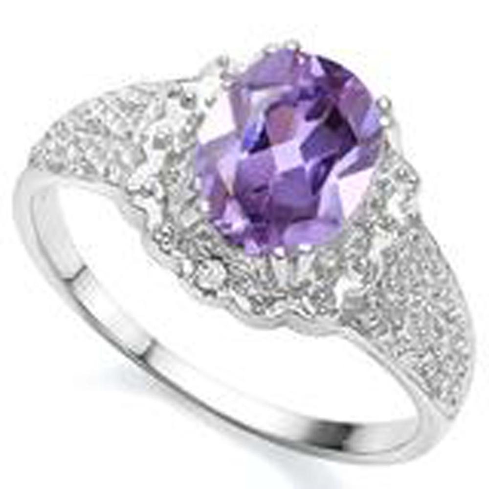 Lot 19: FILIGREE ACCENT STERLING FACETED AMETHYST 2CT RING