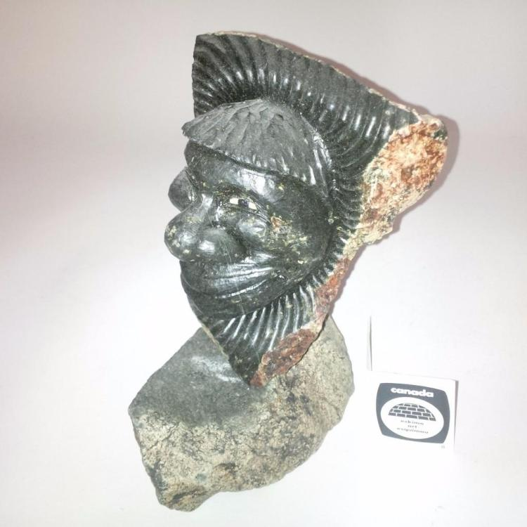 Inuit soapstone sculpture by artist joseph suqsuaq face o