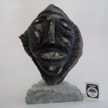 Inuit Soapstone Structure by Artist: Charlie Okpik. Face on base. Circa 1990.