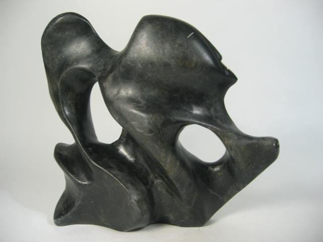 Original Inuit Soapstone Carving by Artist: Alex Alikashuak. Sedna. Circa: 1999. Community: Whale Cove. Dimensions: Approx. 10.5L X 10.5H X 3D inches.Approximate current market value: $2800 - $3000 (Number: 58118)
