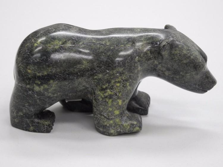 Inuit Stone Sculpture by Artist: Kakee Peter.