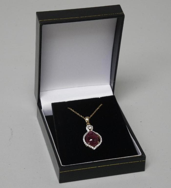 Ladies 14kt Gold / White and Yellow Custom Pendant and Chain, 8.36cts Ruby (Corundum) - Pear Shape (Cabochon) and (.49ct) Round Topaz. GLA Cert. Beverly Hills $2730.00 USD. CAD: $3549.00.
