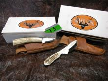 (2) Silver Stag Sheath Knives: Elk Stick Series The Squirrel (TS2.0) Steel Blade, Shed Elk or Deer Antler Handle, Handmade Leather Sheath; D2 Slab Series Whitetail Caper (WC3000) Steel Blade, Shed Elk or Deer Antler Handle, Handmade Leather Sheath