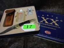 Case Hammerhead Lockback Gift Set. Includes CA-177 (2159L SS) Hammerhead lockback with smooth black synthetic handles, brown leather sheath, hard Arkansas pocket stone and 3 oz. bottle of honing oil. Comes inside a 9