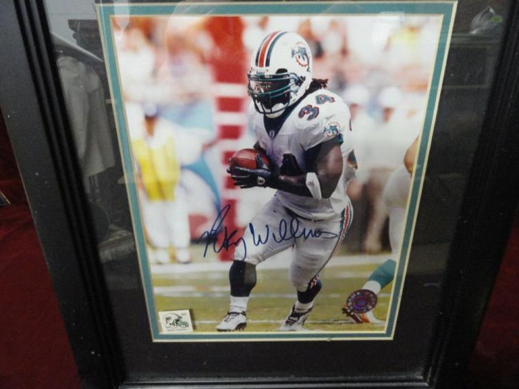 RICKY WILLIAMS FRAMED AUTOGRAPHED PICTURE