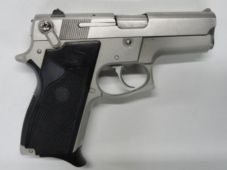 "SMITH & WESSON MOD. 669 SEMI-AUTOMATIC PISTOL. SR # TBD4160. 9 MM CAL. STAINLESS STEEL, BLACK PLASTIC GRIPS. 3.5"" BARREL. 12 ROUND MAGAZINE. VERY GOOD CONDITION"