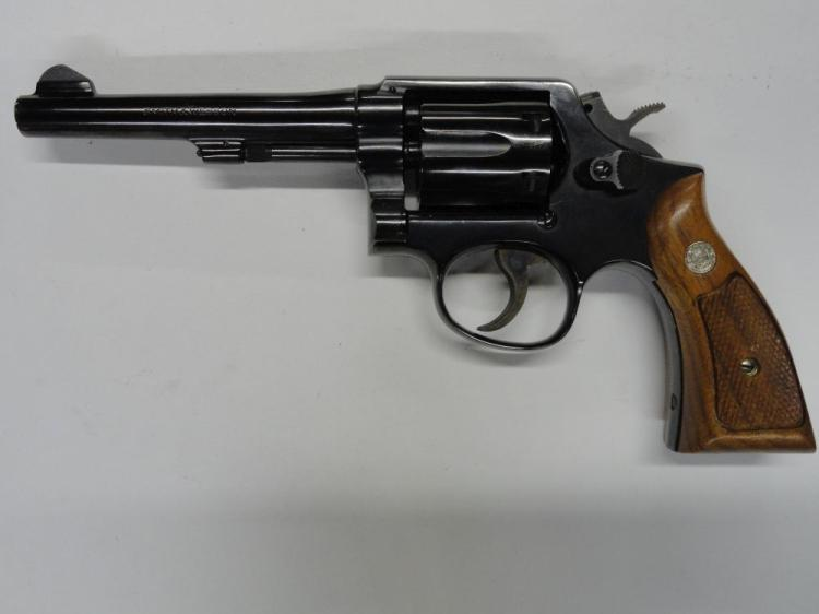"SMITH & WESSON MOD. 10-5 6 SHOT REVOLVER. SR # D137456. .38 SPCL. CAL. BLUE FINISH, WALNUT GRIPS, 5"" BARREL. EXCELLENT CONDITION"