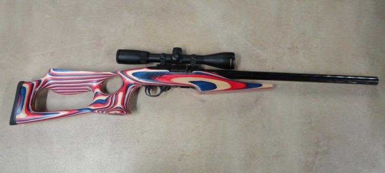 "RUGER MOD. 10/22 BSA RACE RIFLE SEMI-AUTOMATIC, SR # USST01308, 22 LR CAL. BLACK FINISH, RED, WHITE, & BLUE LAMINATED THUMBHOLE STOCK, 20"" BLUED HEAVY BARREL WITH HAMMER-FORGED SPIRAL FINISH, NIKON BUCKMASTERS SCOPE"