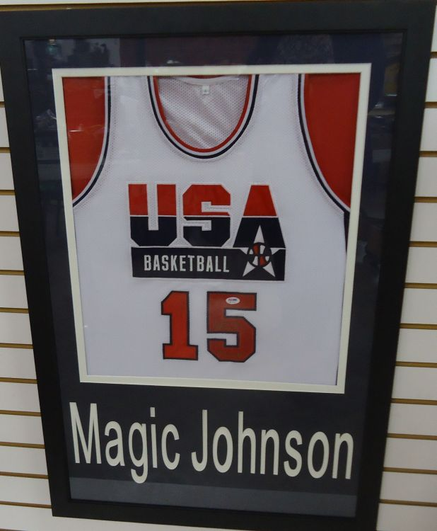 FRAMED AUTOGRAPHED MAGIC JOHNSON OLYMPIC JERSEY, WITH 92 GOLD INSCRIPTION DREAM TEAM YEAR PSA/DNA CERTIFIED JERSEY
