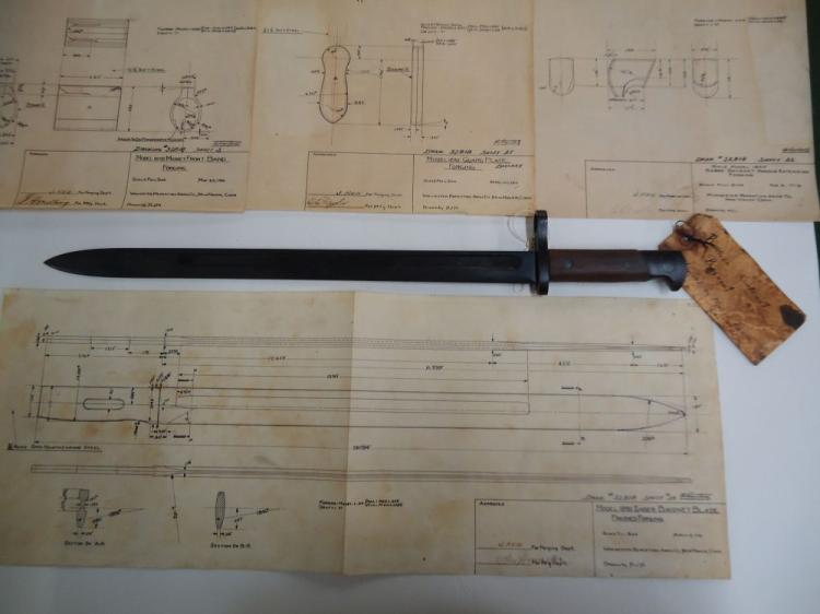 U.S. M1895 WINCHESTER PROTOTYPE BAYONET - HAS SOME OF THE PAPERS AND A DRAWING SHOWING DETAILS. PAPERS ARE SIGNED BY J. REID, ELE TAYLOR, C. HERLING. R.J.M. HAS A PAPER TAG MARKED MODEL FOR RUSSIAN CONTRACT