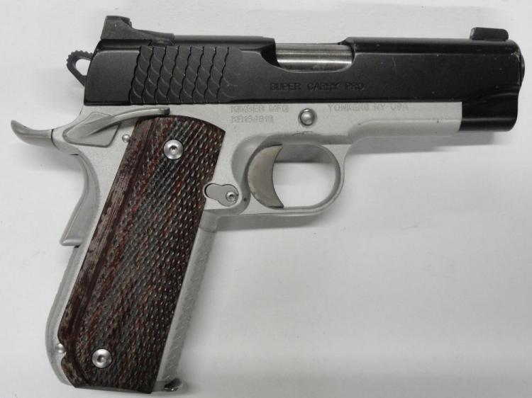 "KIMBER CUSTOM SHOP SUPER CARRY PRO 1911 SEMI-AUTOMATIC PISTOL. SR # KR164816, .45 ACP CAL. ALUMINUM FRAME WITH BLUED STAINLESS SLIDE, SUPER CARRY SERRATIONS, 4"" BARREL MICARTA LAMINATED GRIPS, TRITIUM NIGHT SIGHTS"