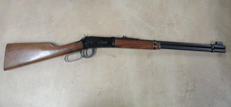 "WINCHESTER MODEL 94 LEVER ACTION RIFLE, SR # 3422764, .32 WIN SPL. CAL. BLUE FINISH, WALNUT STRAIGHT GRIP STOCK & FOREARM, 20"" ROUND BARREL. EXCELLENT CONDITION WITH SOME LIGHT SCRATCHES ON RIGHT SIDE OF RECEIVER. THE STOCK IS VERY GOOD WITH SOME"