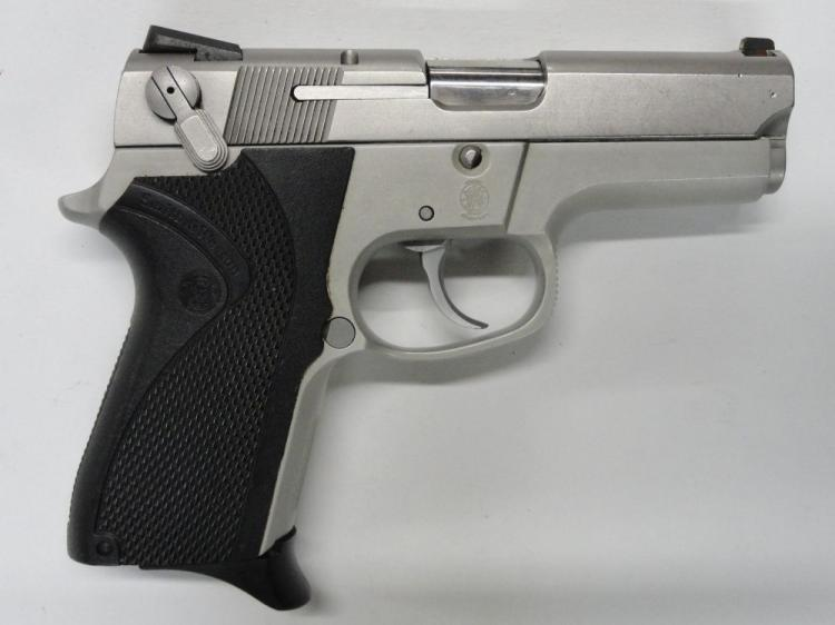 "SMITH & WESSON MOD. 6906 SEMI-AUTOMATIC PISTOL. SR # TVD0014. 9 MM CAL. STAINLESS STEEL SLIDE. ALLOY FRAME, BLACK PLASTIC GRIPS. 3.5"" BARREL. 12 ROUND MAGAZINE. EXCELLENT CONDITION"