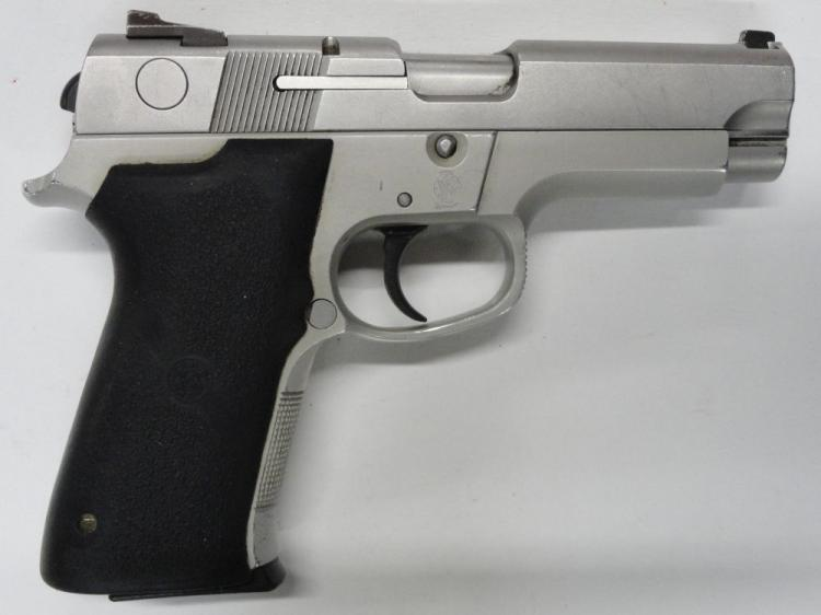 "SMITH & WESSON MOD. 4043 SEMI-AUTOMATIC PISTOL. SR # VBH7884. 40 S&W CAL. STAINLESS STEEL SLIDE, ALLOY FRAME, HOGUE WRAP AROUND RUBBER GRIPS. 3.5"" BARREL. 10 ROUND MAGAZINE. EXCELLENT CONDITION"