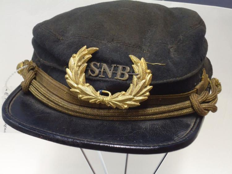 "U.S. CAP, LATE 1888-1902 PERIOD. KEPI OR CHASSEUR TYPE CAP. HAD TWO SIDE BUTTONS, ONE CAME LOOSE. CAP INSIGNIA WITH LETTERS SBL INSIDE A WREATH SEWN ON TO THE CAP. GOLD LACE CAP STRAP, RIM IS ABOUT 1 9/16 "" WIDE, INSIDE CAP IS MKD GEORGE EVANS & COMPANY"