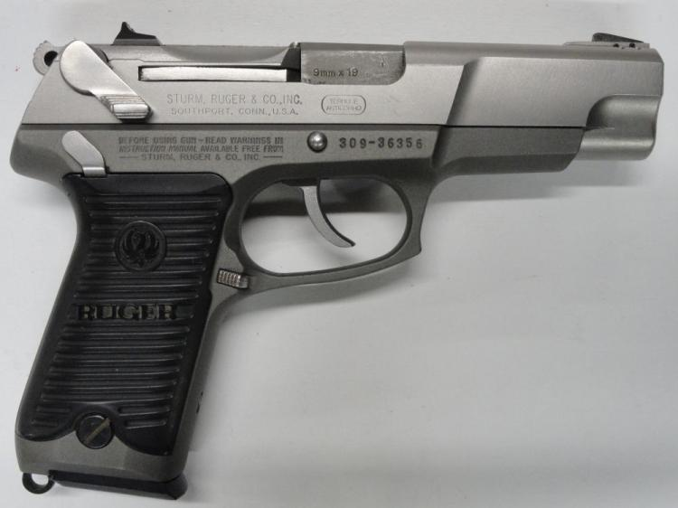 "RUGER MOD. P89 SEMI-AUTOMATIC PISTOL. SR # 309-36356, 9 MM CAL. STAINLESS STEEL SLIDE & FRAME, BLACK PLASTIC RUGER GRIPS. 4.5"" BARREL, 15 ROUND MAGAZINE. EXCELLENT CONDITION"